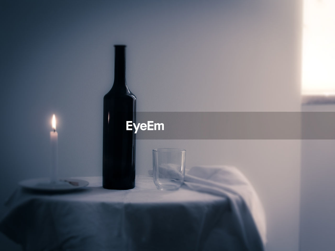 candle, indoors, no people, bottle, close-up, flame, table, burning, wineglass, day