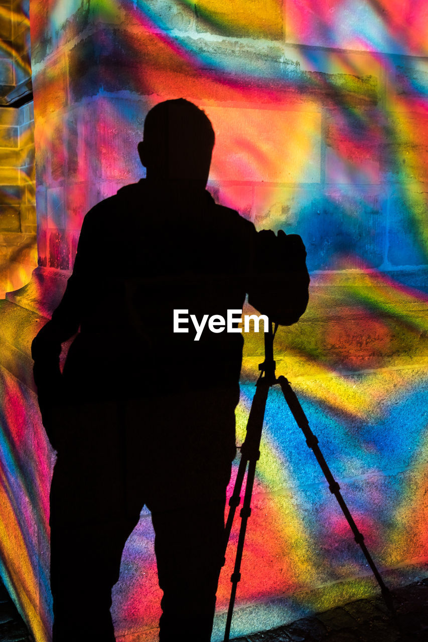 multi colored, one person, silhouette, real people, rear view, standing, men, photography themes, lifestyles, technology, activity, occupation, creativity, leisure activity, camera - photographic equipment, artist, photographing, tripod, graffiti, digital camera, photographer, nightlife