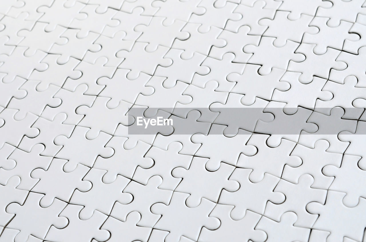 puzzle, pattern, full frame, jigsaw piece, backgrounds, jigsaw puzzle, no people, solution, leisure games, large group of objects, close-up, indoors, leisure activity, connection, studio shot, textured, high angle view, white color, incomplete, paper, blank, complexity