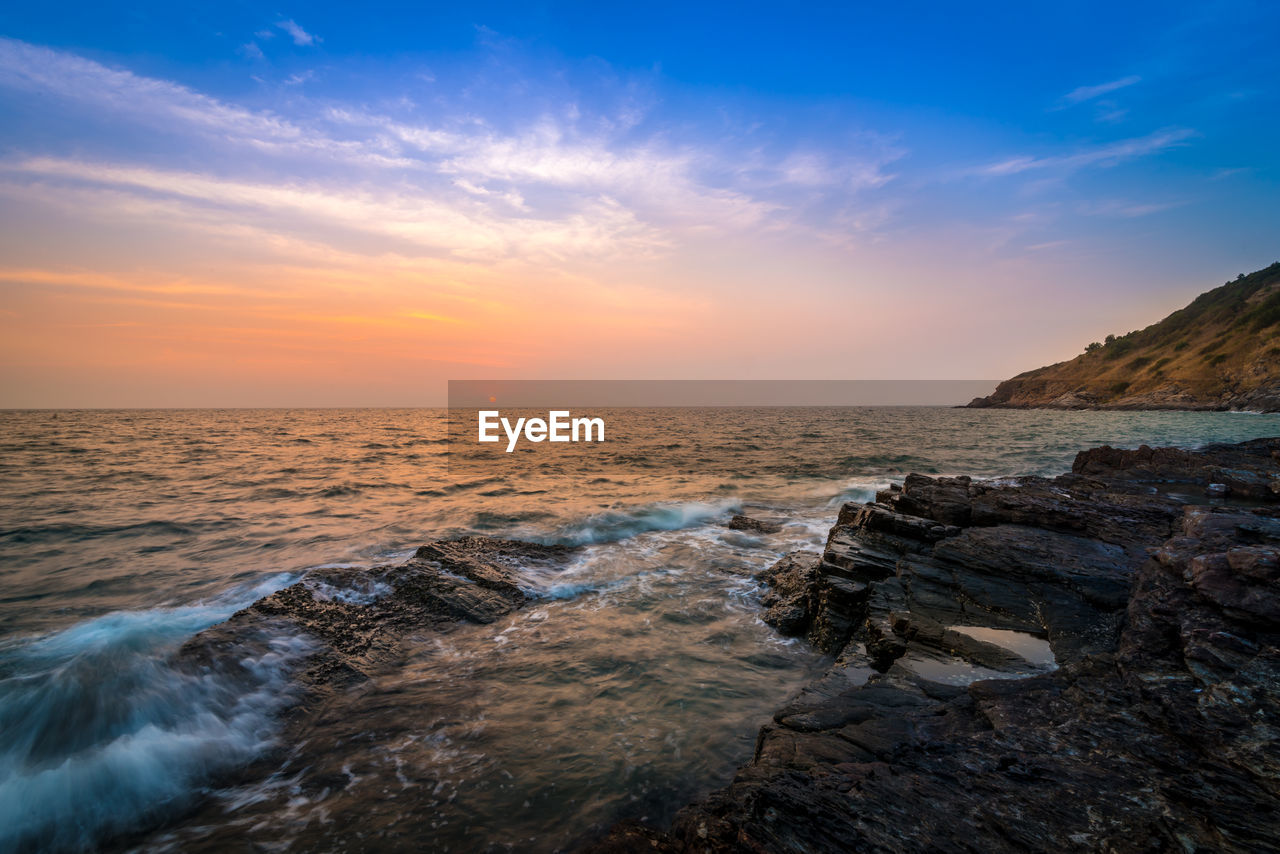 sea, nature, water, beauty in nature, scenics, sunset, sky, rock - object, tranquil scene, tranquility, idyllic, horizon over water, outdoors, beach, no people, wave, motion, day