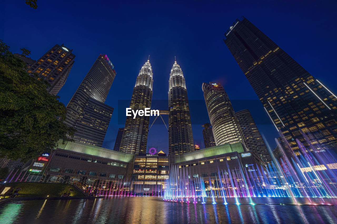 ILLUMINATED MODERN BUILDINGS IN CITY