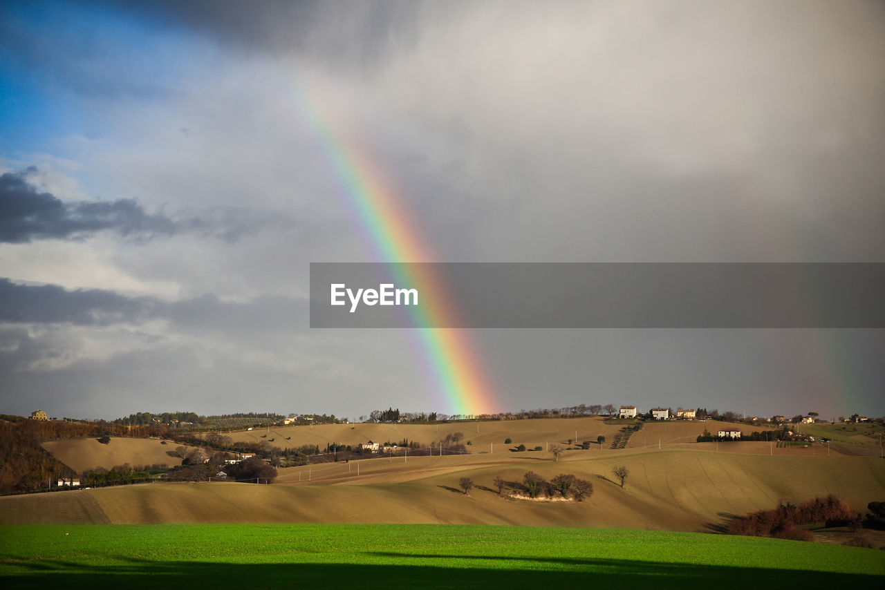 rainbow, beauty in nature, scenics - nature, landscape, cloud - sky, sky, environment, land, tranquility, tranquil scene, nature, field, non-urban scene, no people, multi colored, day, natural phenomenon, idyllic, plant, double rainbow, outdoors
