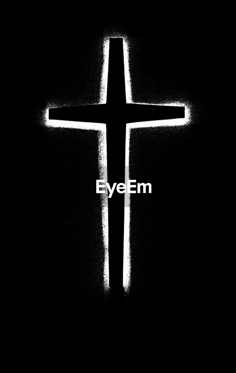 Cross Against Black Background