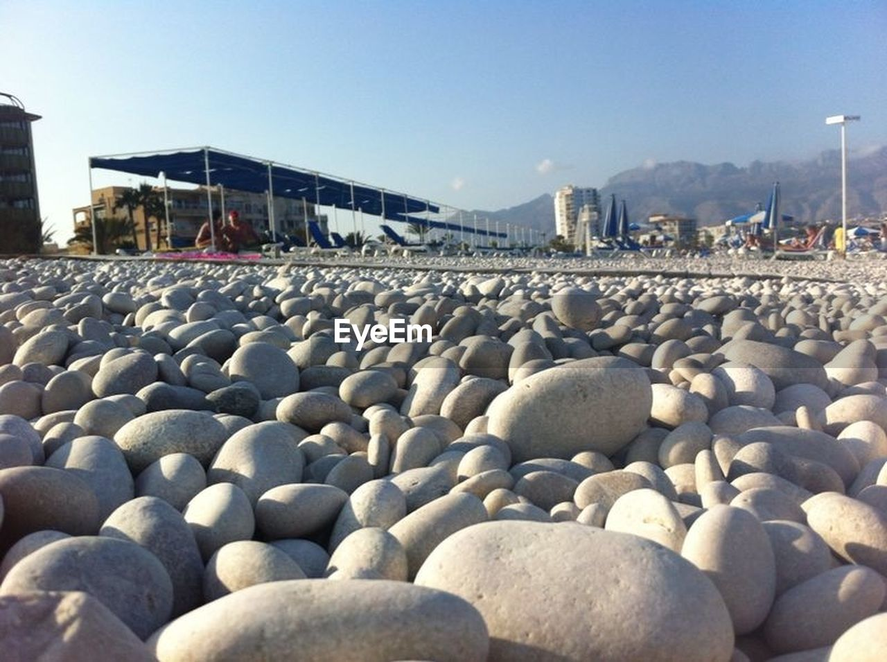 pebble, beach, day, outdoors, clear sky, built structure, no people, architecture, sky, building exterior, pebble beach, water