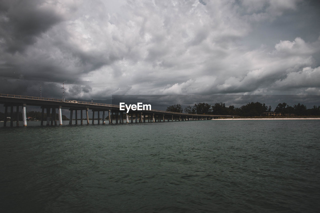 cloud - sky, sky, water, built structure, architecture, waterfront, no people, nature, bridge - man made structure, day, tranquility, outdoors, sea, scenics, storm cloud, beauty in nature