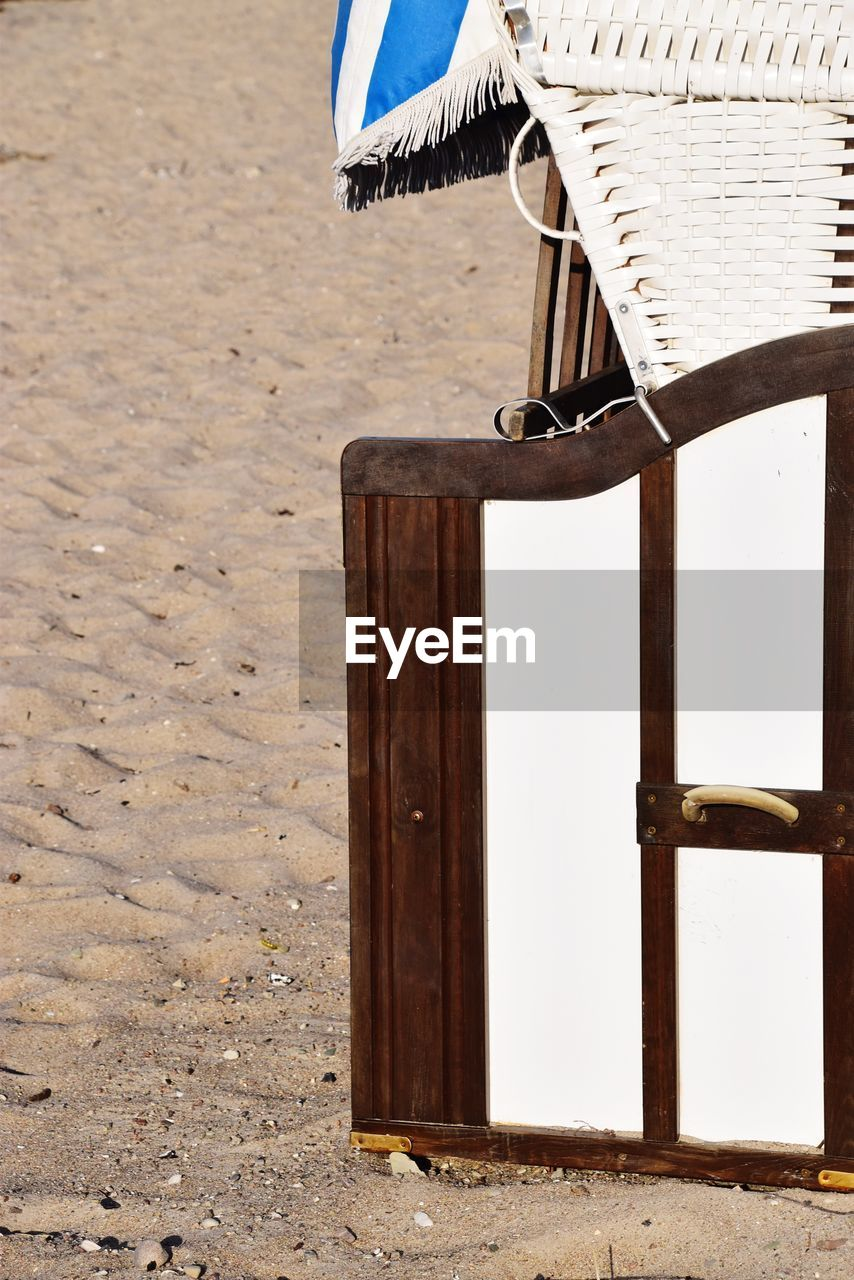 wood - material, land, beach, sand, chair, absence, no people, seat, day, nature, table, outdoors, relaxation, protection, empty, focus on foreground, sunlight, summer, security, sea