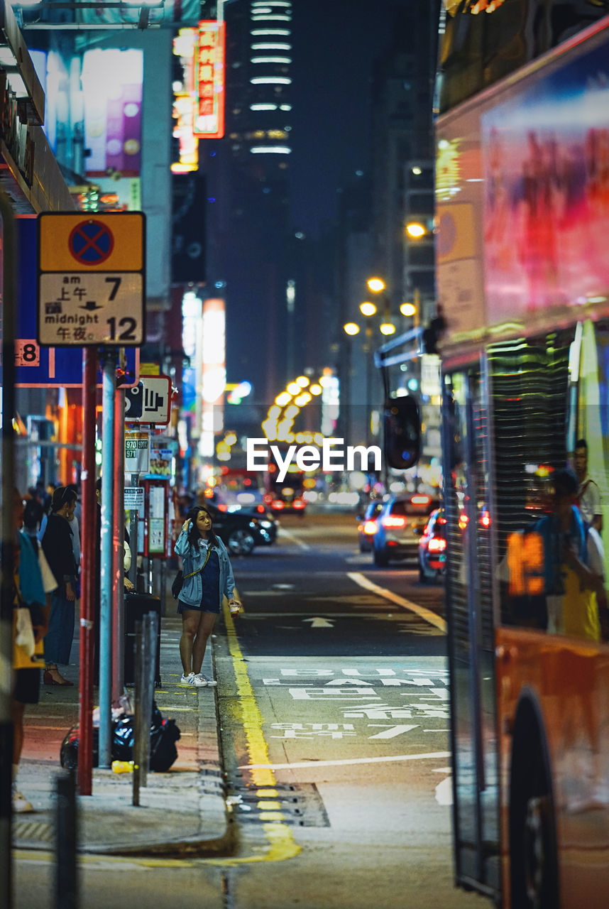 city, transportation, street, illuminated, mode of transportation, architecture, building exterior, land vehicle, road, night, built structure, city street, car, motor vehicle, city life, communication, sign, text, incidental people, travel, outdoors