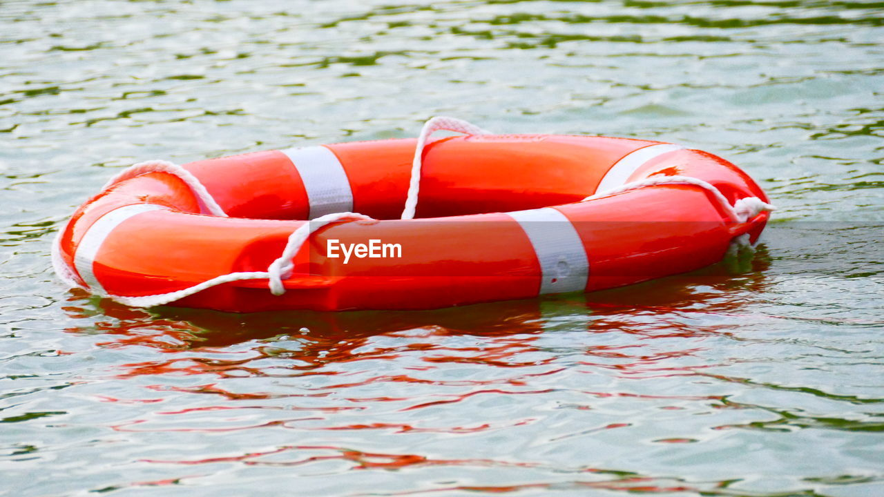 water, waterfront, red, floating, safety, security, floating on water, no people, nature, orange color, day, protection, inflatable, outdoors, tubing, buoy, lake, tube, life belt