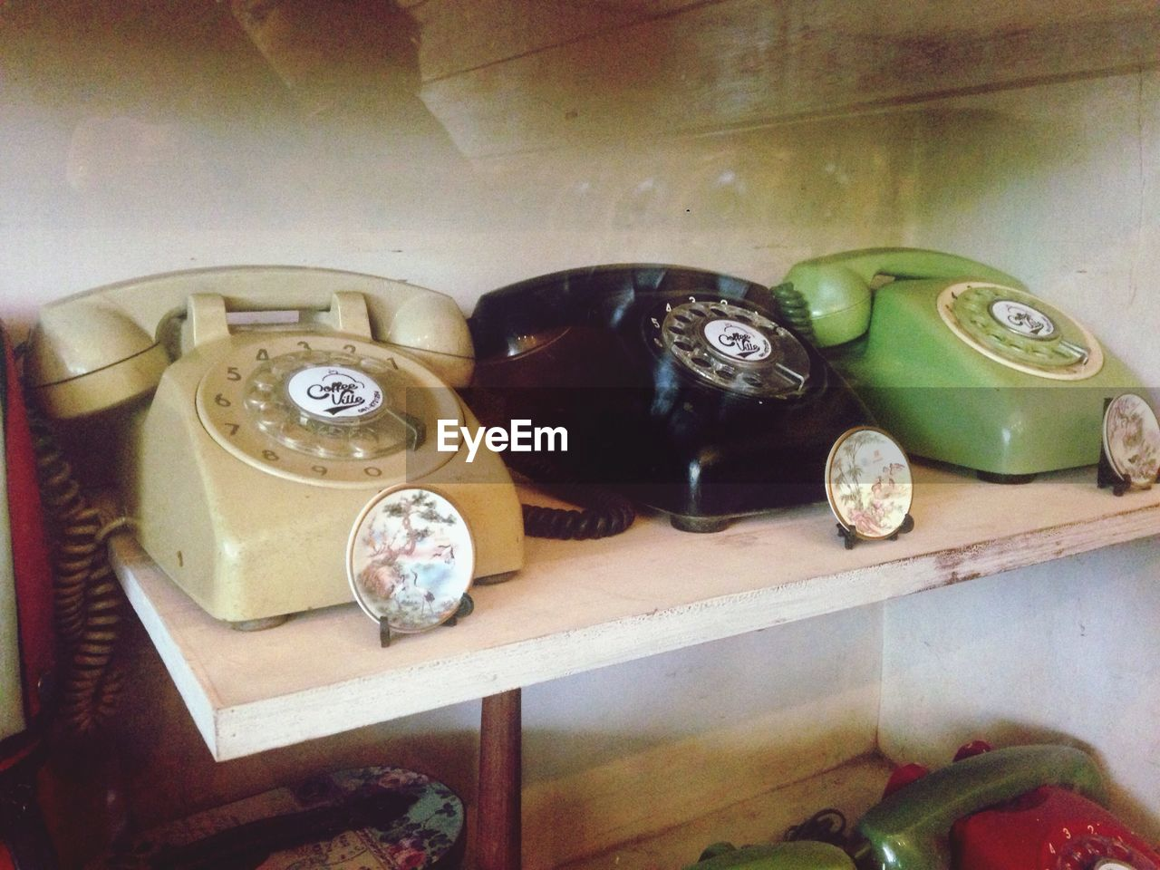telephone, old-fashioned, rotary phone, retro styled, landline phone, telephone receiver, communication, connection, antique, technology, table, indoors, vintage, high angle view, obsolete, dial, no people, telecommunications equipment, time, shelf, close-up, clock, day
