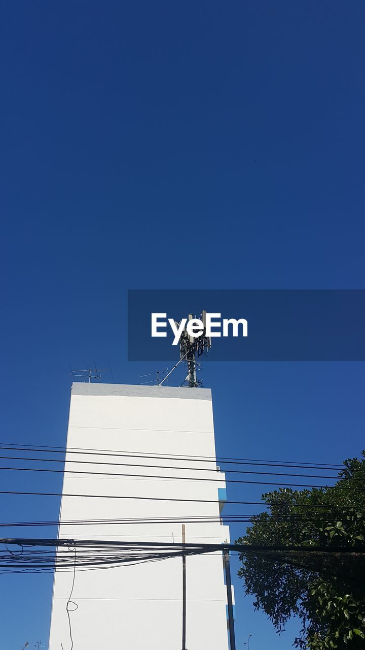 blue, technology, clear sky, copy space, connection, communication, low angle view, outdoors, day, wireless technology, no people, architecture, sky, tree