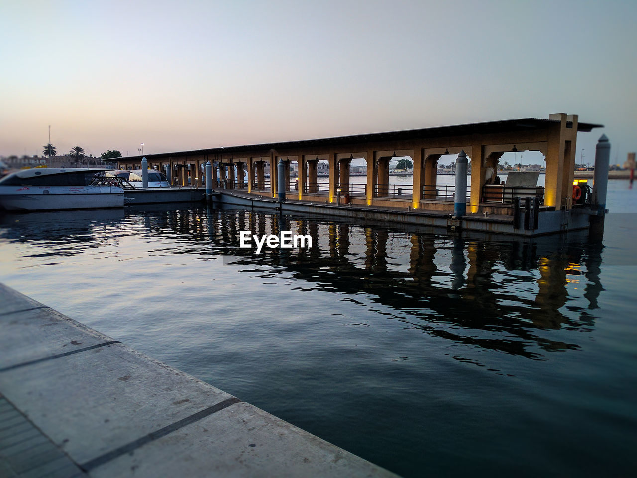 water, pier, built structure, architecture, transportation, sea, outdoors, nautical vessel, bridge - man made structure, clear sky, mode of transport, nature, waterfront, jetty, day, sunset, no people, sky, beauty in nature