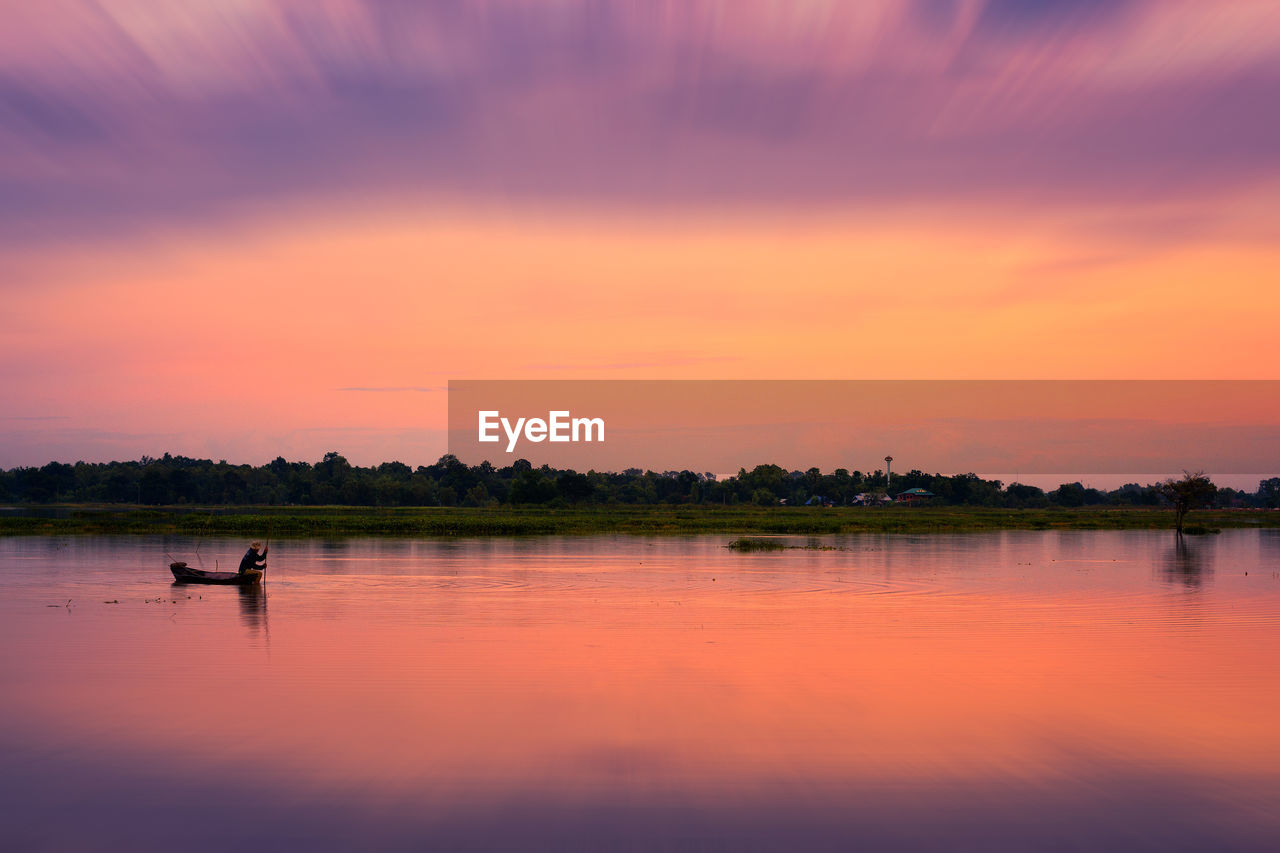 sky, sunset, water, lake, beauty in nature, scenics - nature, reflection, orange color, real people, tranquility, waterfront, tranquil scene, lifestyles, cloud - sky, two people, men, idyllic, non-urban scene, nature, outdoors