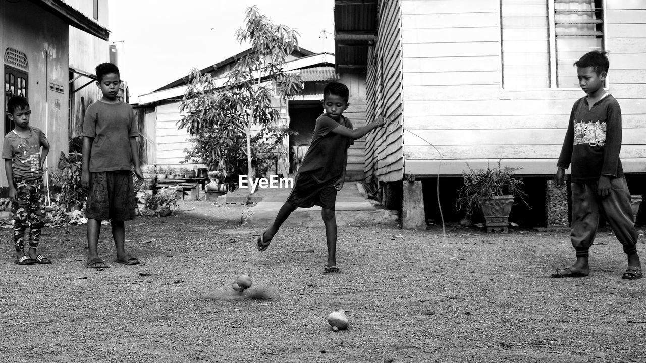 Boy with friends playing on field