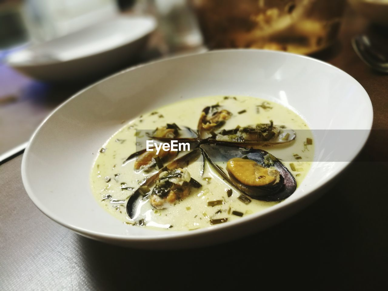 Close-up of seafood served in bowl on table