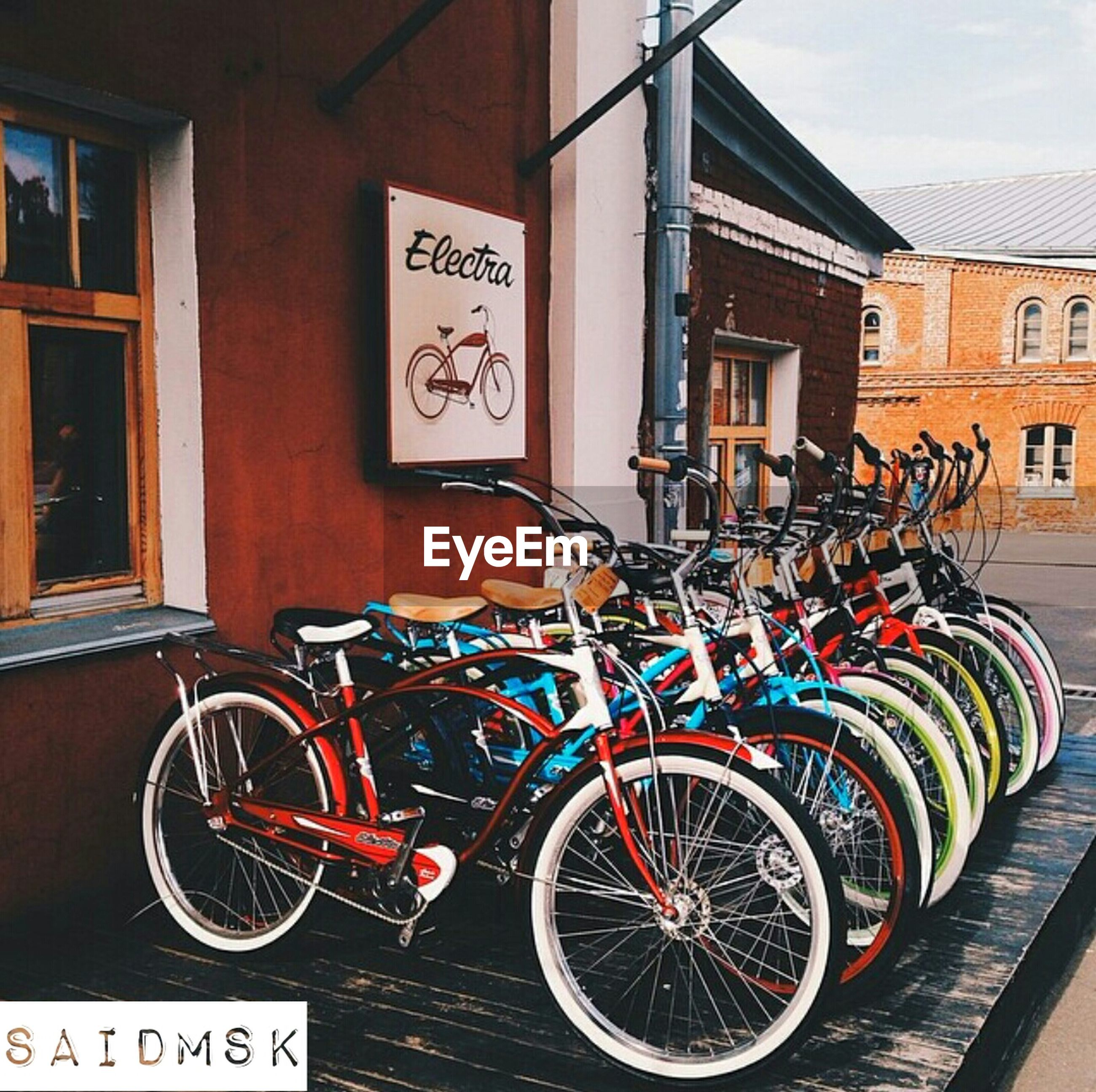 building exterior, bicycle, architecture, built structure, transportation, mode of transport, stationary, parked, land vehicle, graffiti, parking, text, wall - building feature, house, street, day, outdoors, no people, store, residential structure