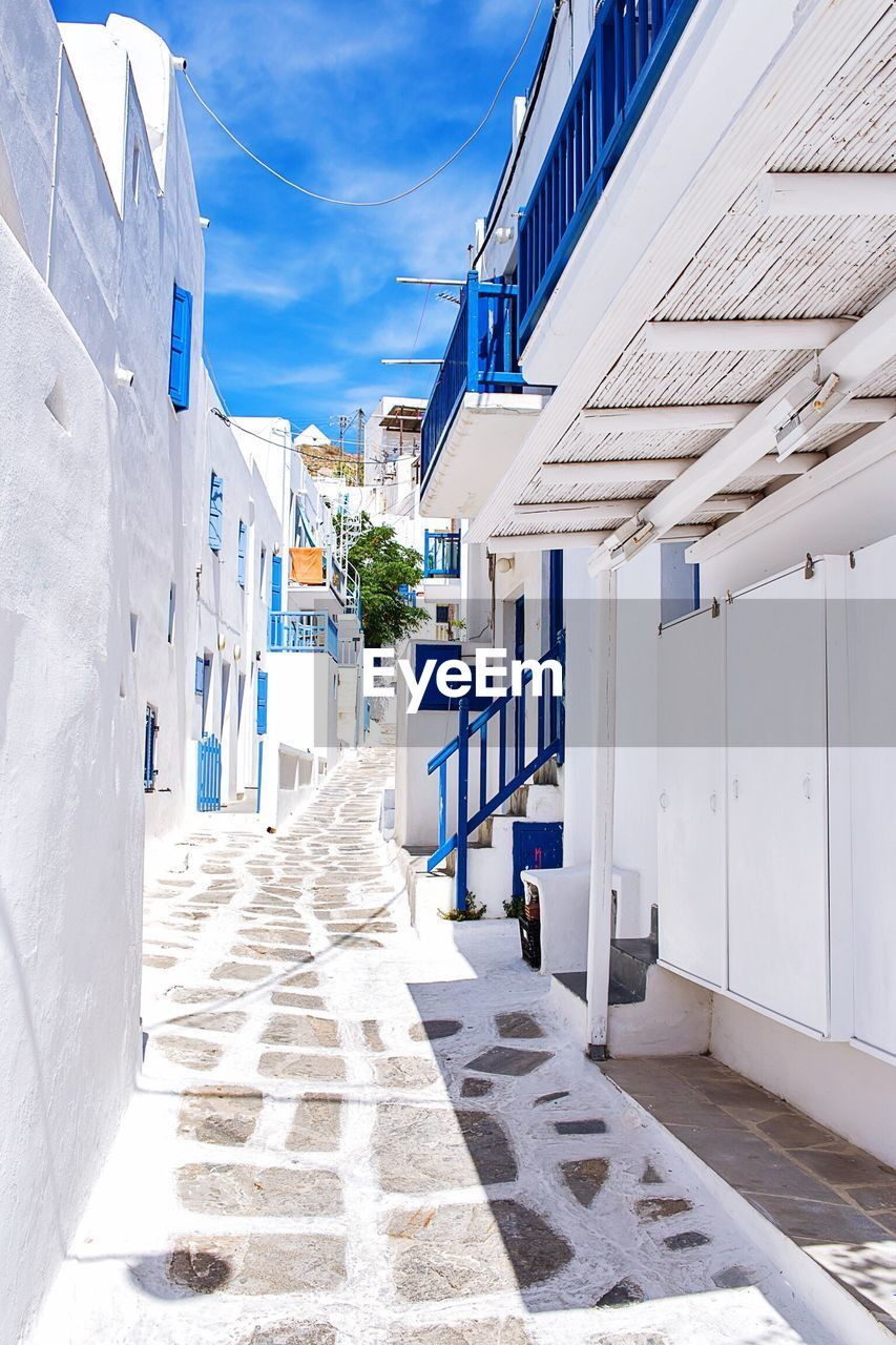 Road amidst buildings at mykonos