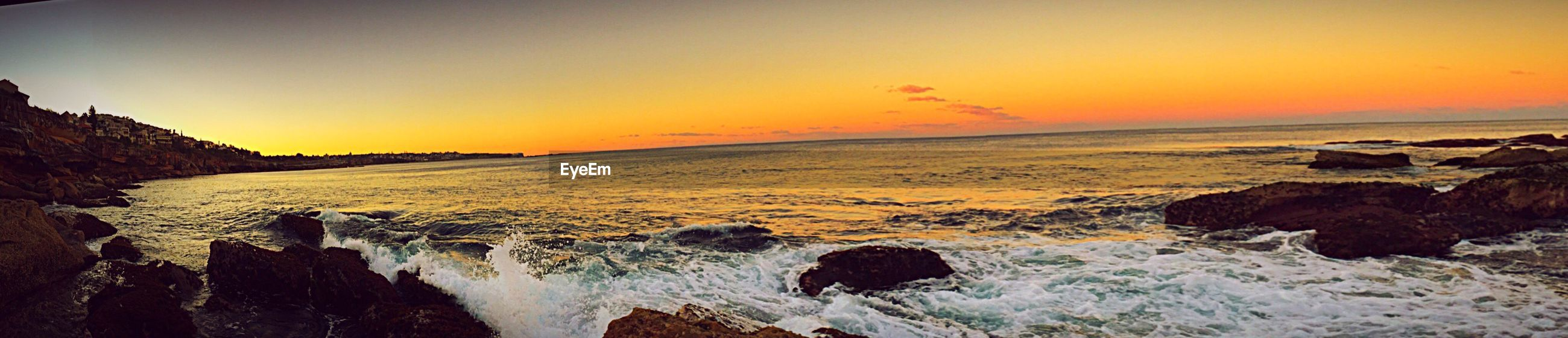 sunset, sea, water, scenics, tranquil scene, beauty in nature, rock - object, tranquility, horizon over water, orange color, idyllic, nature, sky, non-urban scene, remote, outdoors, majestic, rocky, shore, calm, rock formation, wave, coastline, rocky coastline, seascape, waterfront, cliff, tourism, vacations