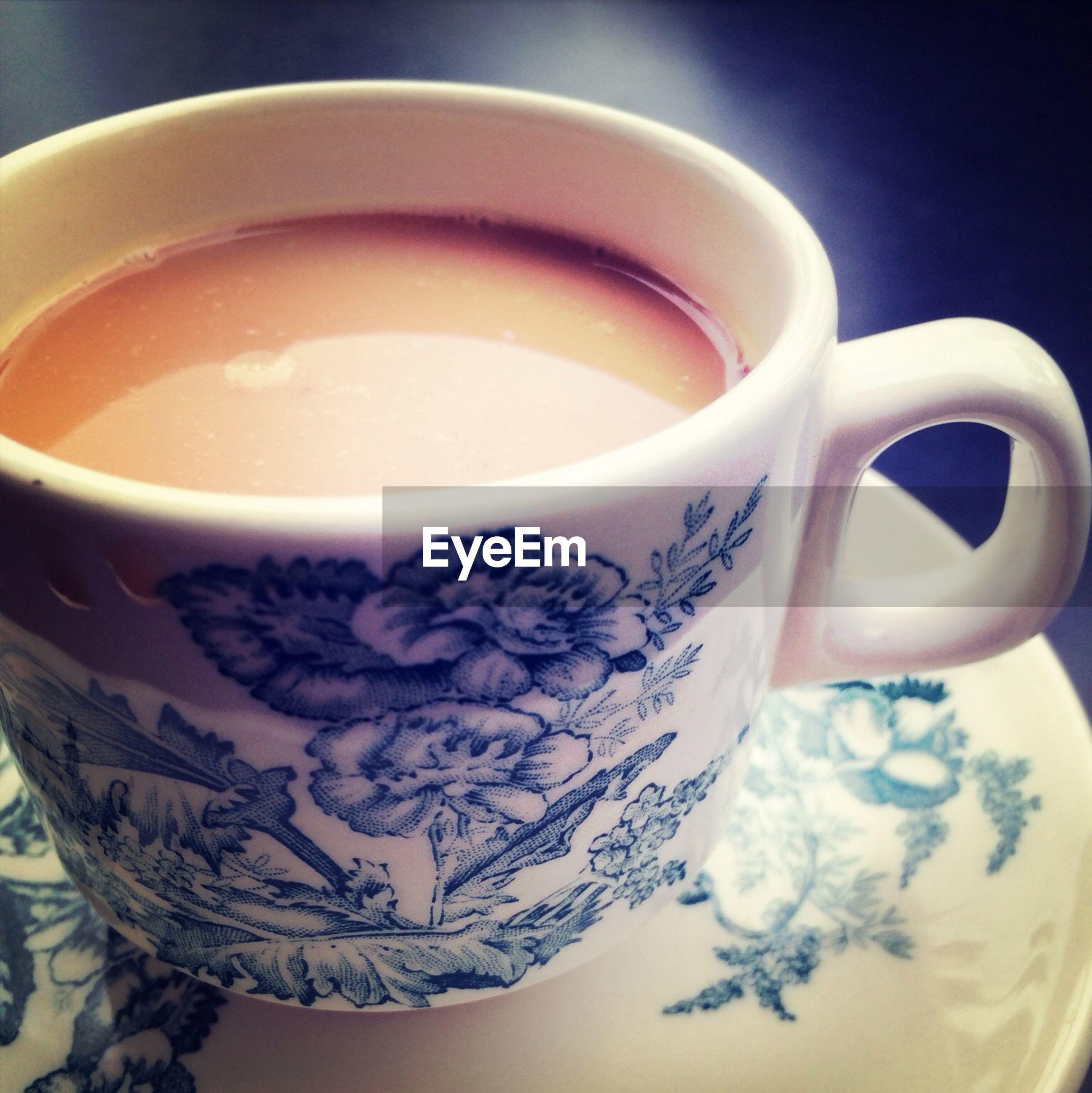 Close-up of designed tea cup