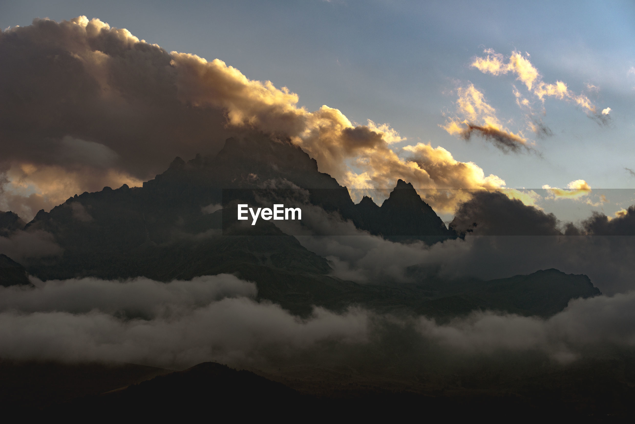Low angle view of silhouette mountain against sky