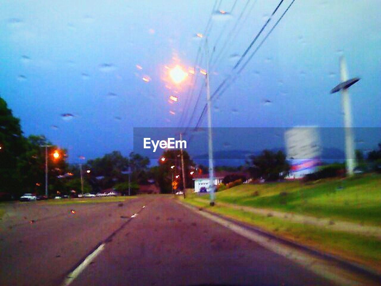 transportation, road, car, illuminated, no people, street, street light, land vehicle, night, mode of transport, sky, outdoors, the way forward, grass, nature