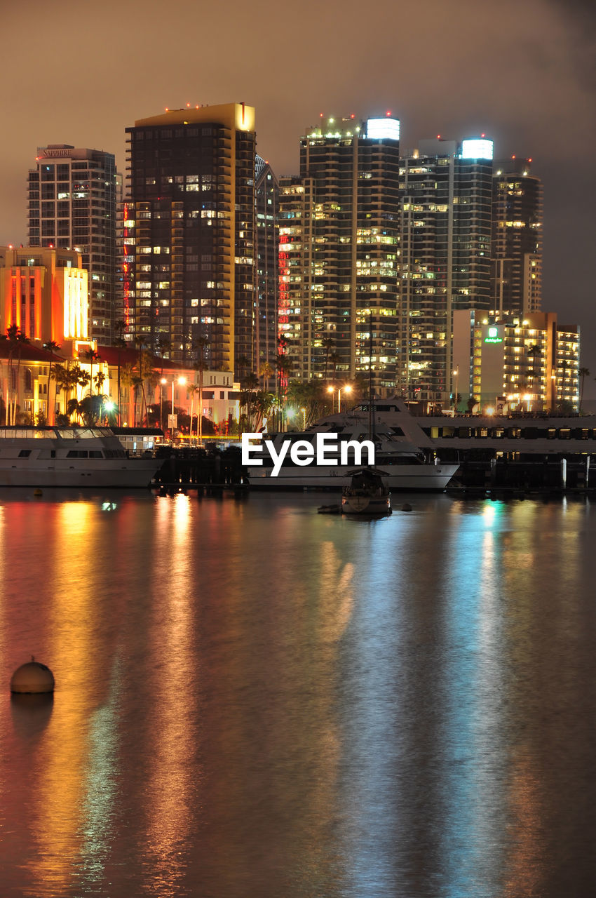 architecture, building exterior, waterfront, water, illuminated, built structure, city, reflection, skyscraper, night, river, no people, cityscape, travel destinations, sky, nautical vessel, outdoors, nature