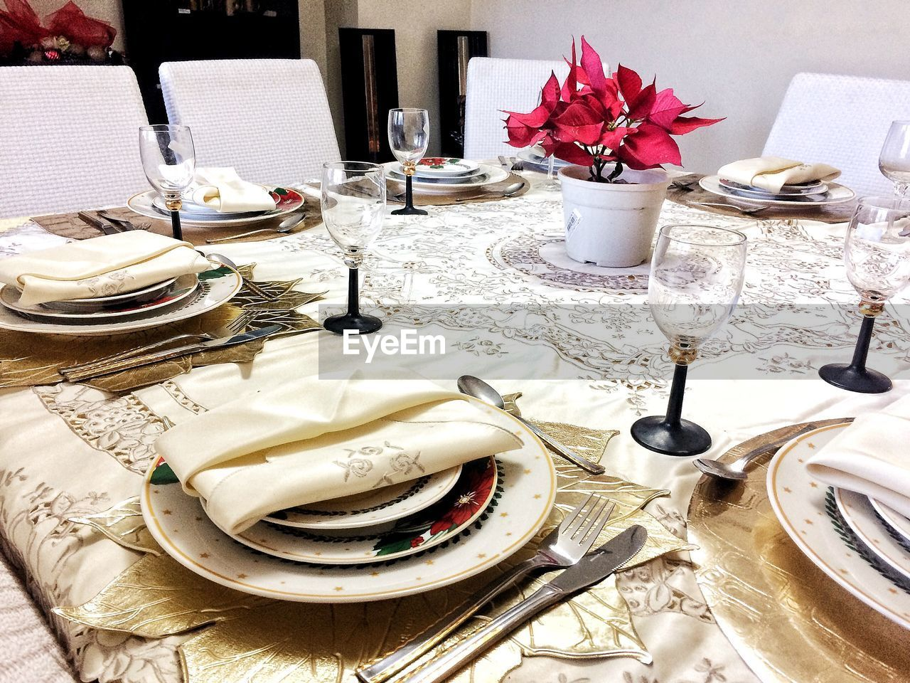 table, plate, kitchen utensil, eating utensil, flower, setting, place setting, flowering plant, spoon, household equipment, no people, food and drink, indoors, fork, knife, still life, tablecloth, freshness, dining table, glass, table knife, crockery