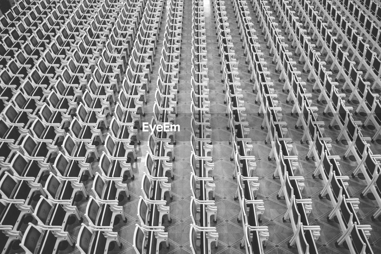 High Angle View Of Empty Chairs Arranged On Floor