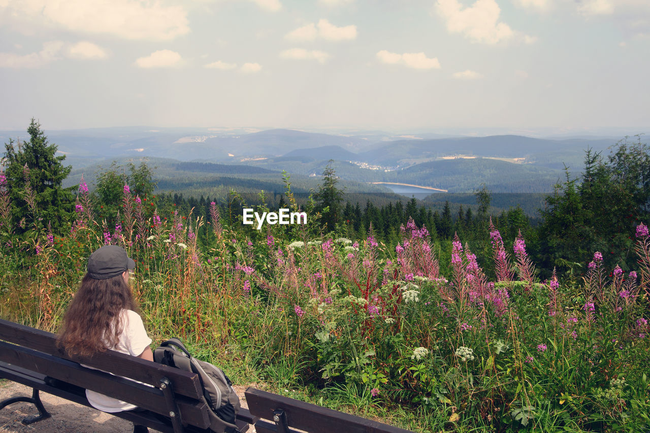 Woman Looking At View While Sitting On Bench