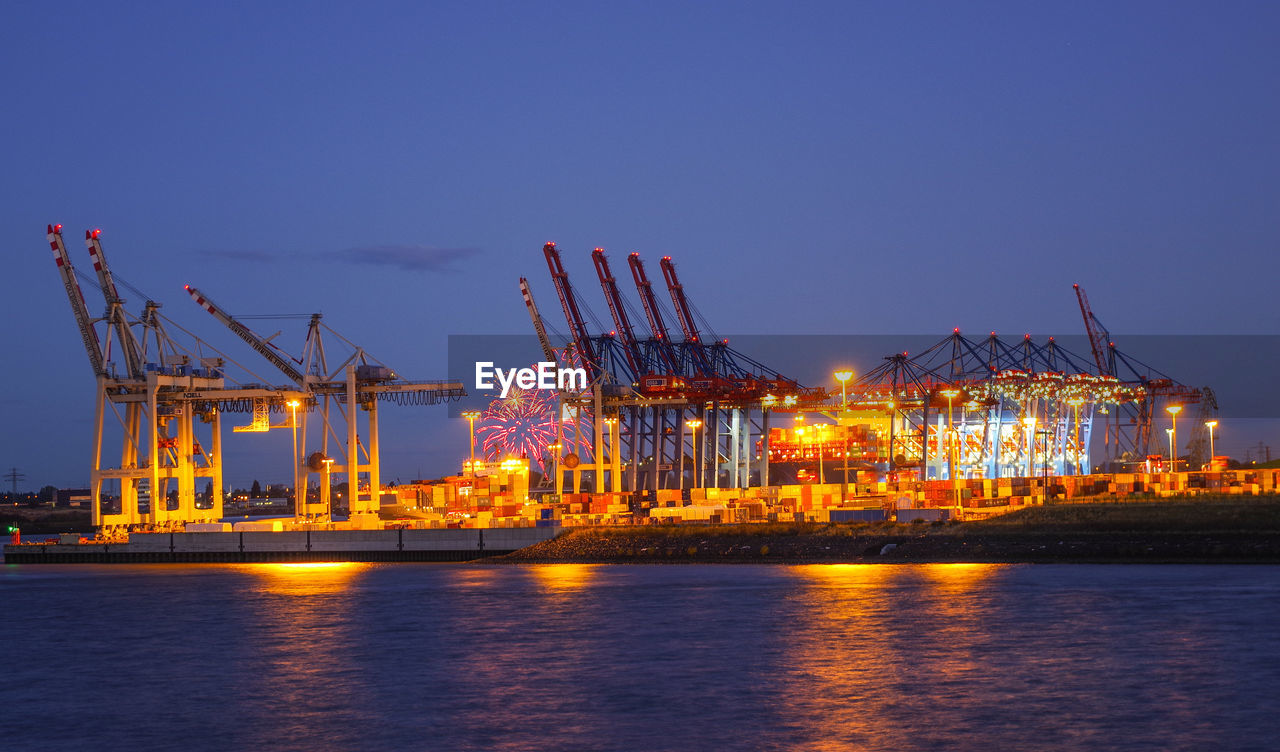 water, industry, machinery, crane - construction machinery, commercial dock, freight transportation, sky, illuminated, pier, architecture, waterfront, shipping, transportation, harbor, business, nautical vessel, sea, night, nature, no people, outdoors, industrial equipment