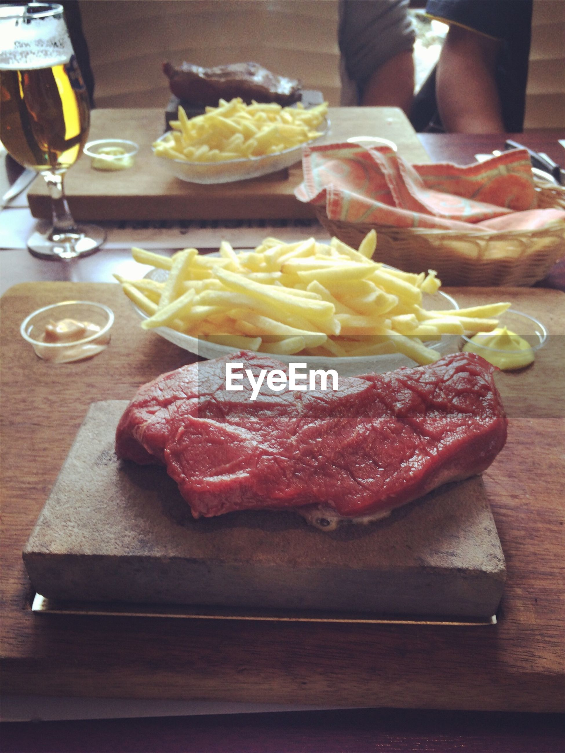 High angle view of steak and french fries on table