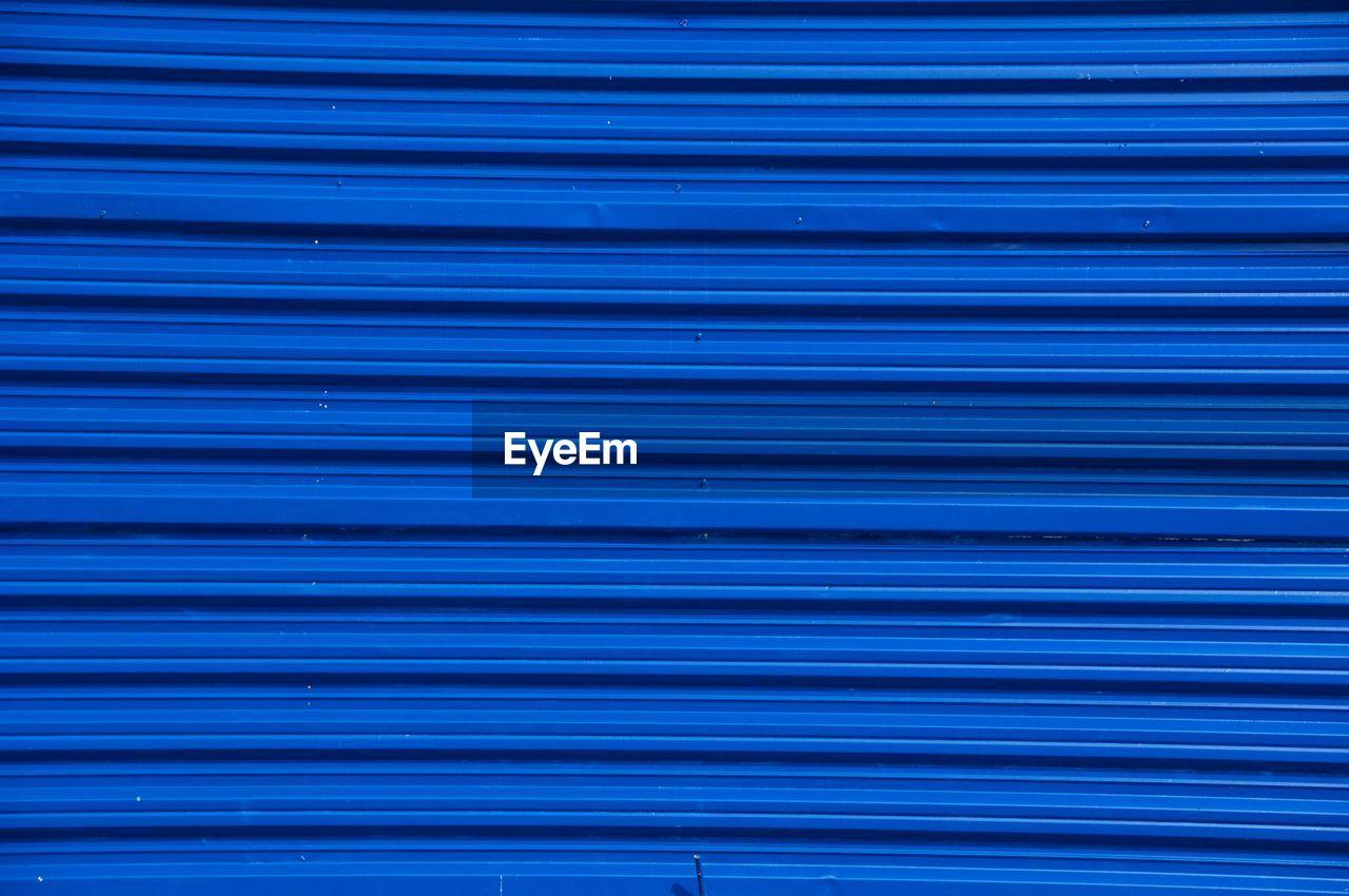 Full Frame Shot Of Blue Shutter