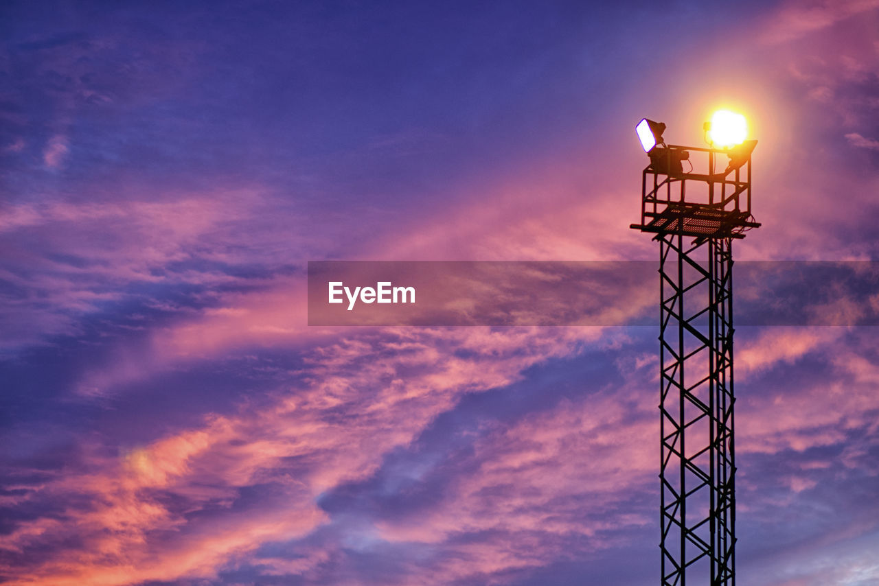 cloud - sky, sky, low angle view, architecture, nature, built structure, sunset, no people, tower, lighting equipment, metal, outdoors, orange color, illuminated, tall - high, technology, beauty in nature, blue, scenics - nature, dusk