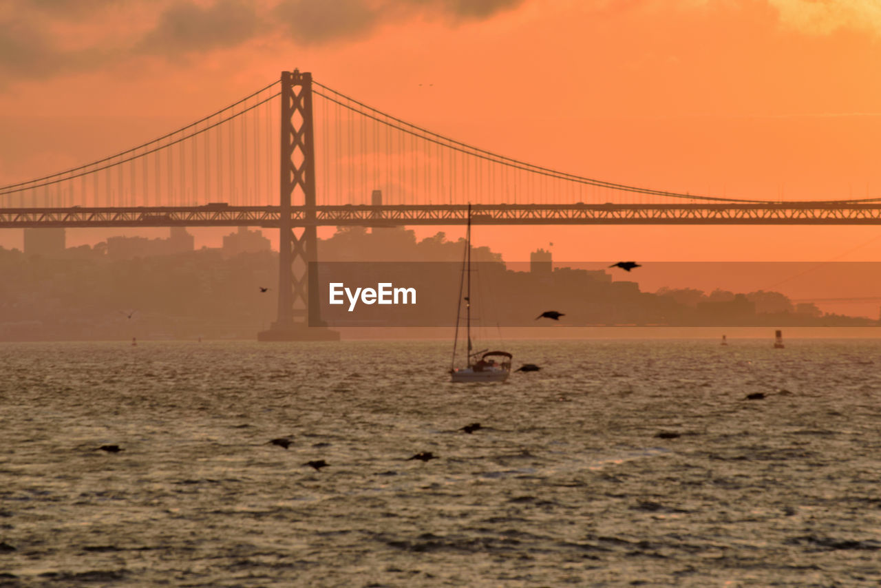 water, sky, sea, nature, sunset, waterfront, connection, transportation, built structure, no people, bridge, architecture, bridge - man made structure, outdoors, scenics - nature, beauty in nature, suspension bridge, land, tranquility, bay