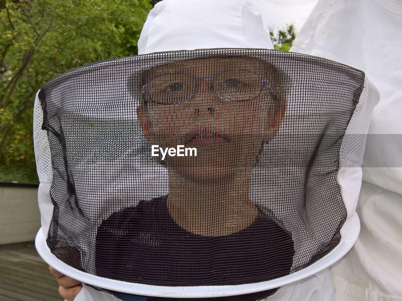 Portrait Of Beekeeper Wearing Protective Workwear