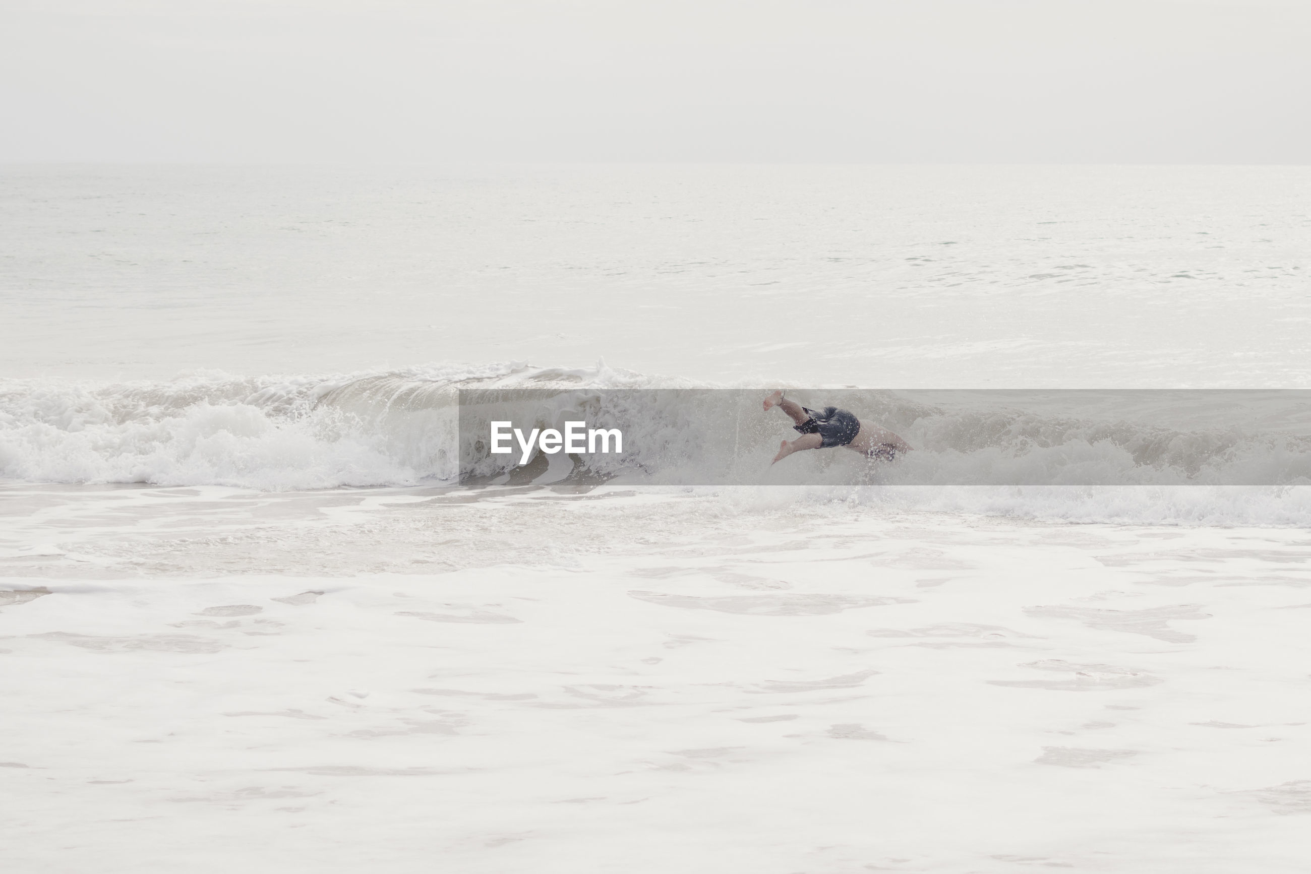 Man diving into sea