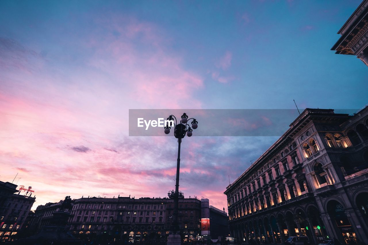 building exterior, built structure, architecture, sky, city, cloud - sky, nature, lighting equipment, low angle view, street, building, sunset, dusk, street light, no people, residential district, outdoors, illuminated, pink color, city life