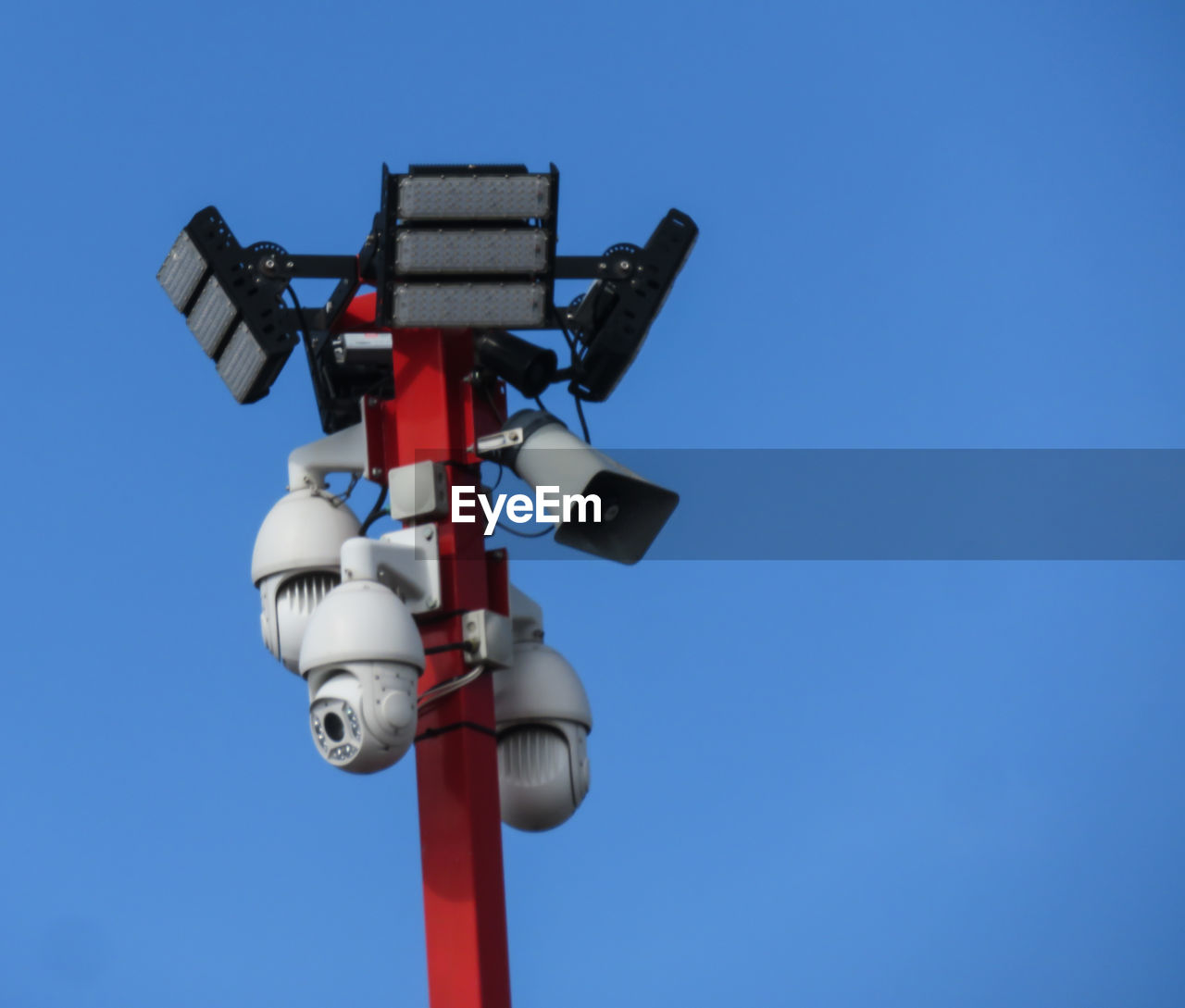 clear sky, sky, low angle view, blue, day, no people, copy space, nature, technology, lighting equipment, outdoors, sunlight, communication, red, sign, light, pole, transportation, signal, white color, crossing sign