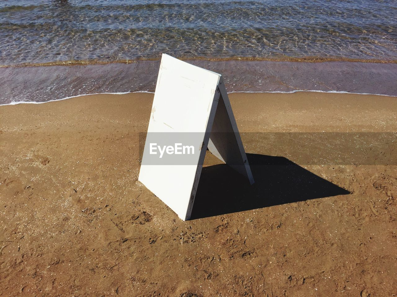 High angle view of blank signboard at beach