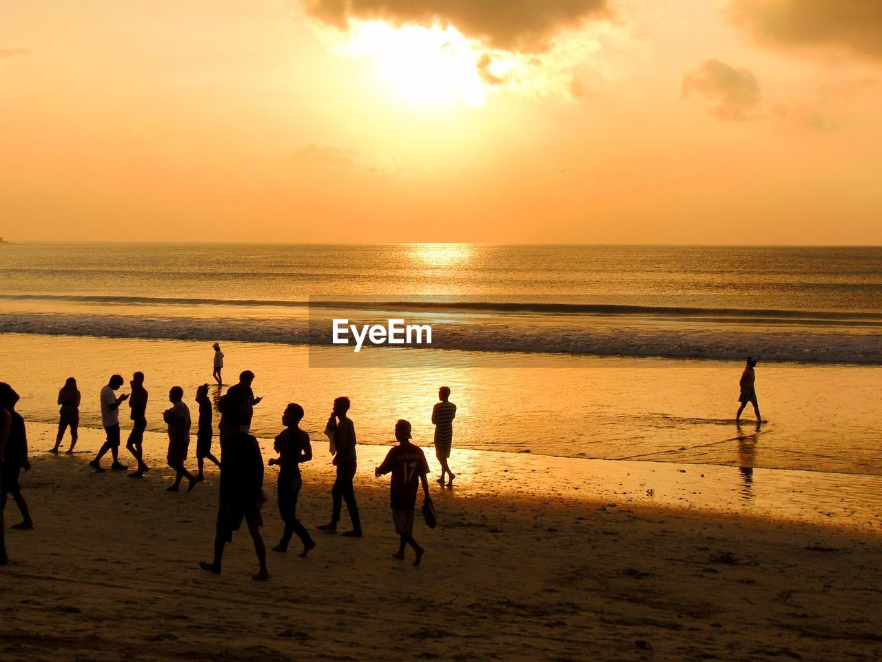 sky, sunset, sea, water, beach, land, horizon over water, group of people, horizon, scenics - nature, orange color, beauty in nature, real people, lifestyles, men, silhouette, leisure activity, nature, sun, outdoors