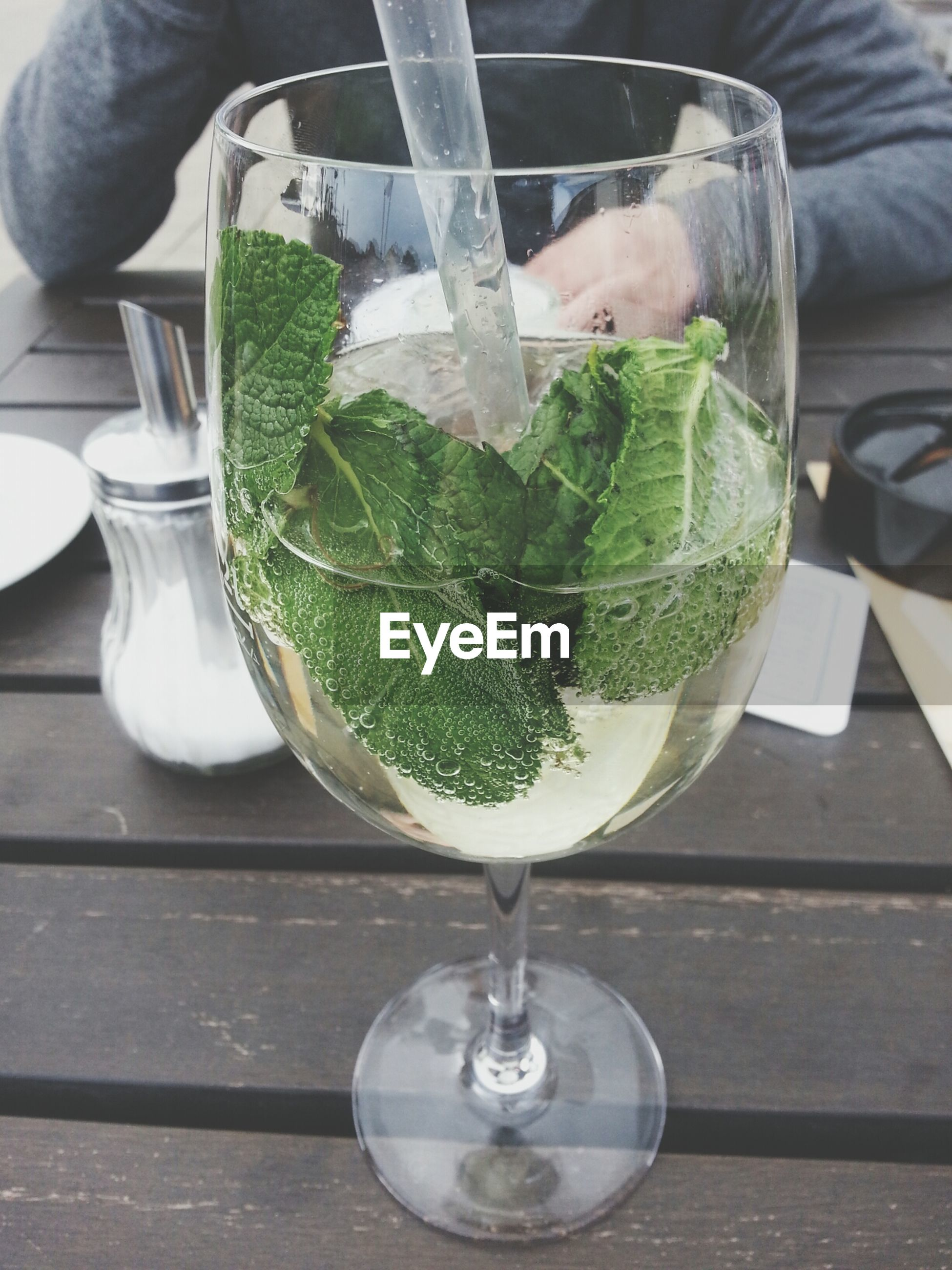food and drink, drinking glass, table, drink, glass - material, indoors, freshness, refreshment, transparent, close-up, still life, wineglass, glass, alcohol, cocktail, drinking straw, wine, focus on foreground, water, healthy eating