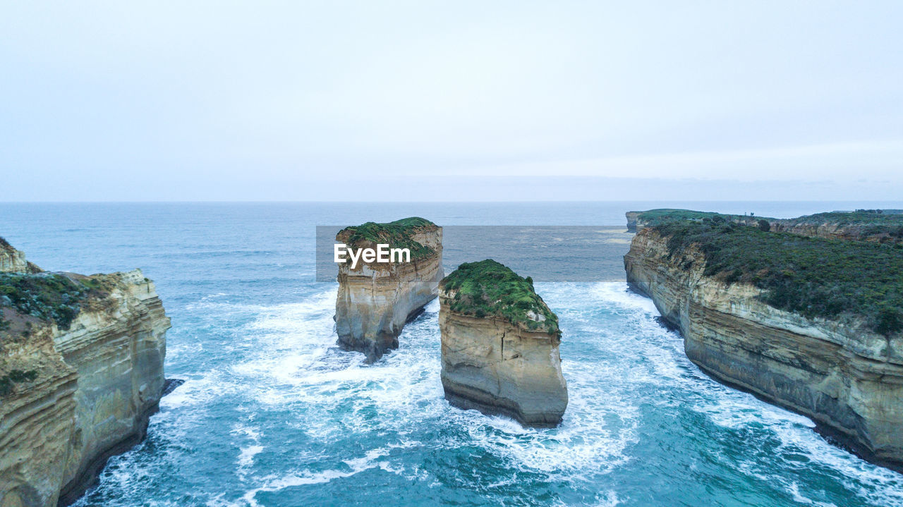 sea, water, sky, horizon over water, scenics - nature, horizon, beauty in nature, rock, rock - object, nature, solid, tranquil scene, tranquility, day, no people, rock formation, land, motion, copy space, outdoors, stack rock, eroded