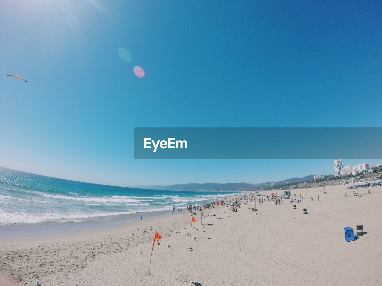 Scenic View Of Sea Against Clear Blue Sky During Sunny Day