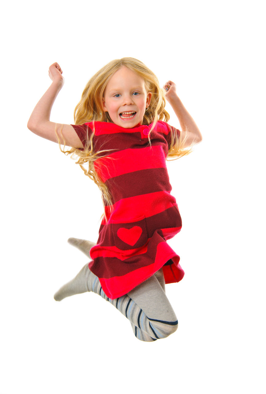 childhood, child, girls, white background, looking at camera, happiness, portrait, smiling, hair, emotion, cut out, females, women, blond hair, studio shot, full length, indoors, cheerful, one person, cute, innocence, human arm, positive emotion, hairstyle, arms raised, excitement