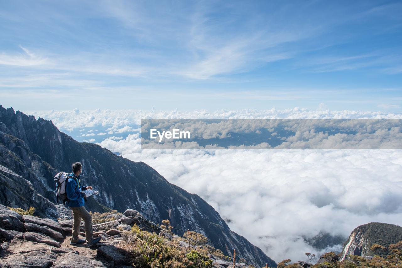 High Angle View Of Hiker On Mountain