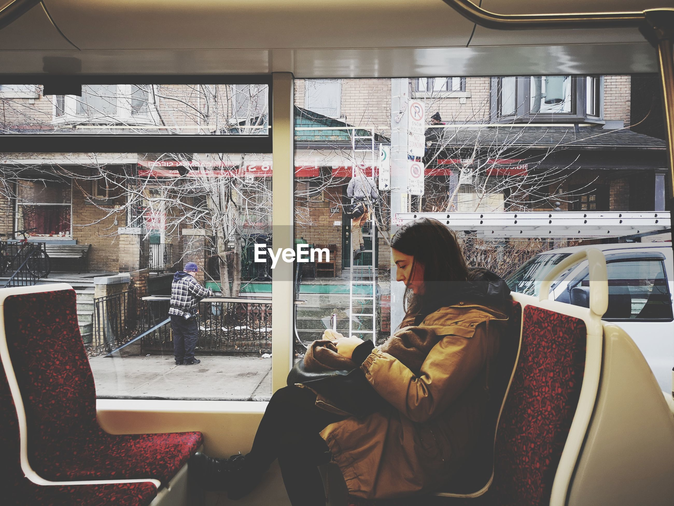 Side view of woman sitting in bus