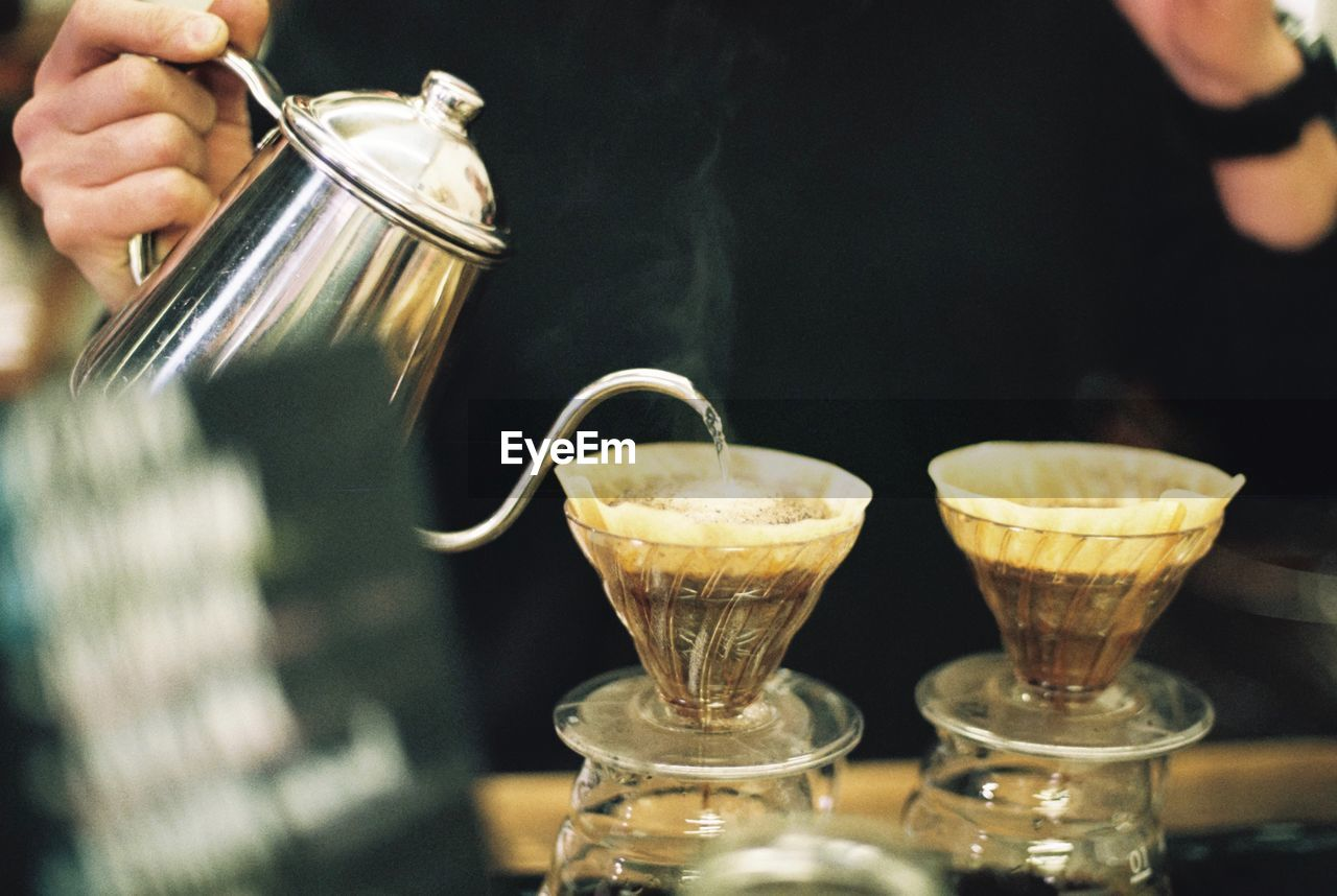 Close-Up Of Person Making Coffee