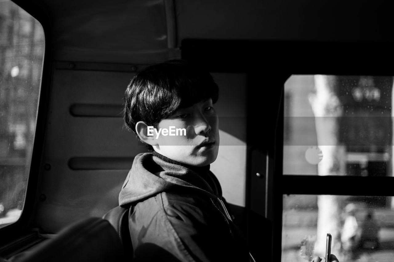 Portrait of man sitting on bus