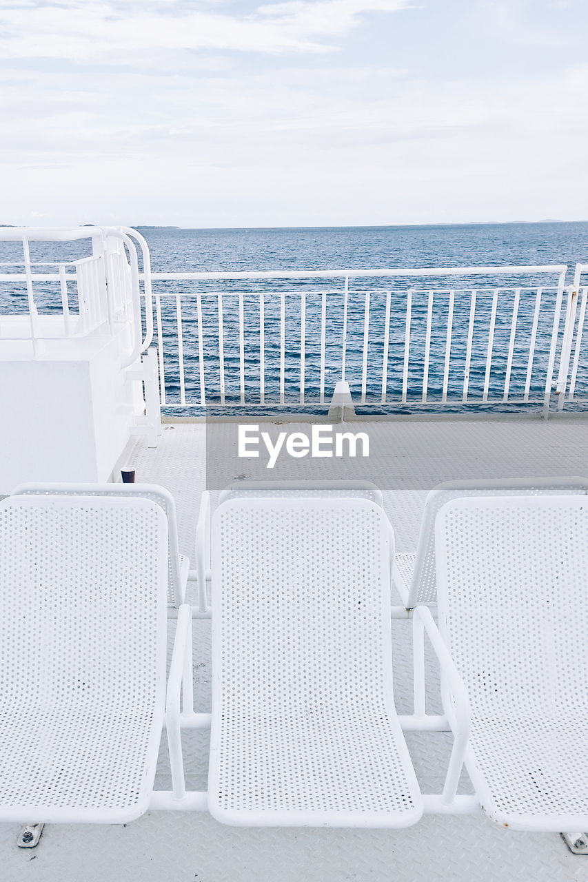 White chairs on boat deck