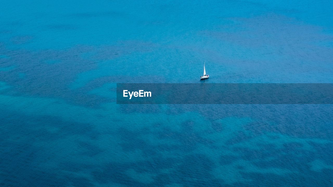 Aerial View Of Sailboat On Sea Against Sky