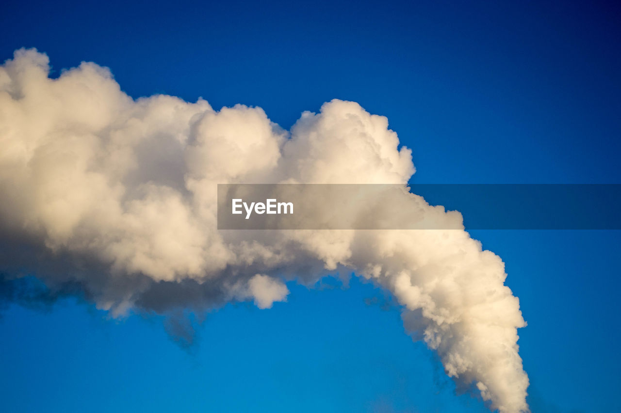 Smoke Stack Against Clear Blue Sky